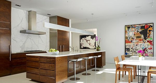 Wooden-furnished-kitchen-cabinets-and-furniture-with-wall-art